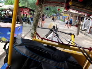 scuba bag on horse drawn carriage, gili trawagan, lombok, indonesia