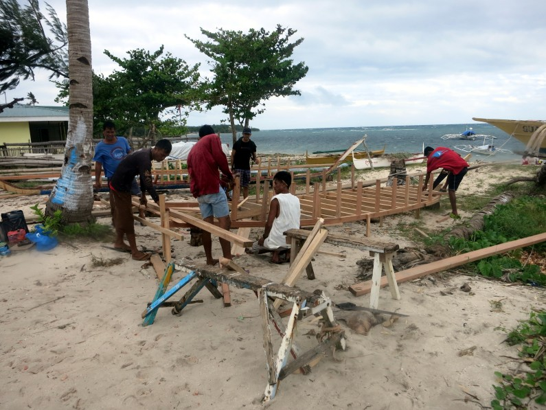 Building boats on the beach Malapascua Philippines