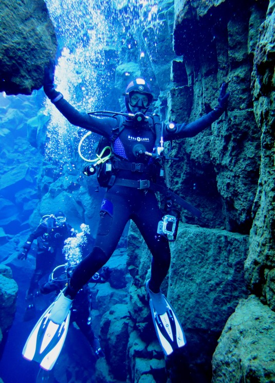 Scuba diver between American and European tectonic plate in Silfra Iceland