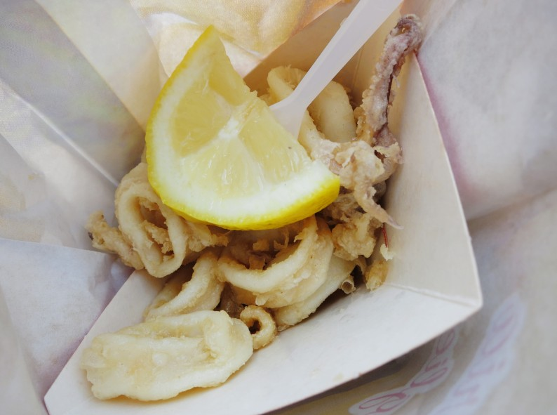 fried squid fesh lemon for lunch Cinque Terre Italy