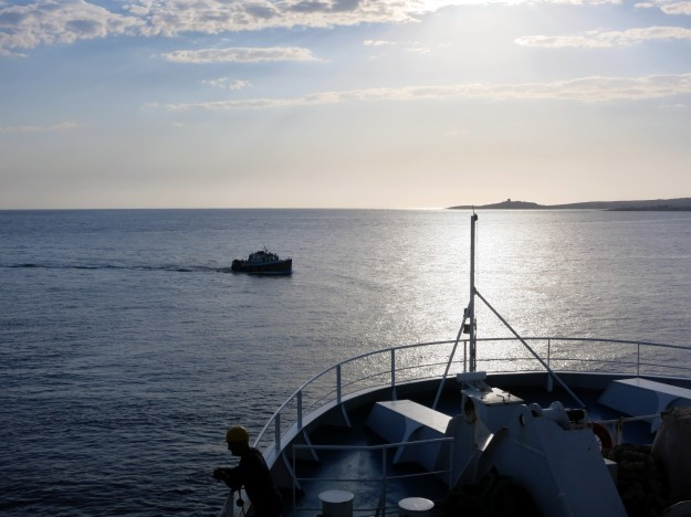 Ferry from Malta to Gozo at sunrise