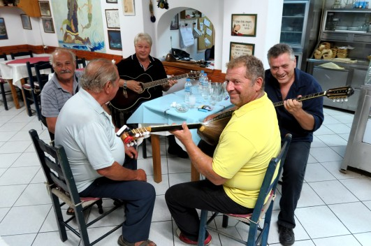 owner and friends playing bouzouki in a Greek taverna Alonissos Greece